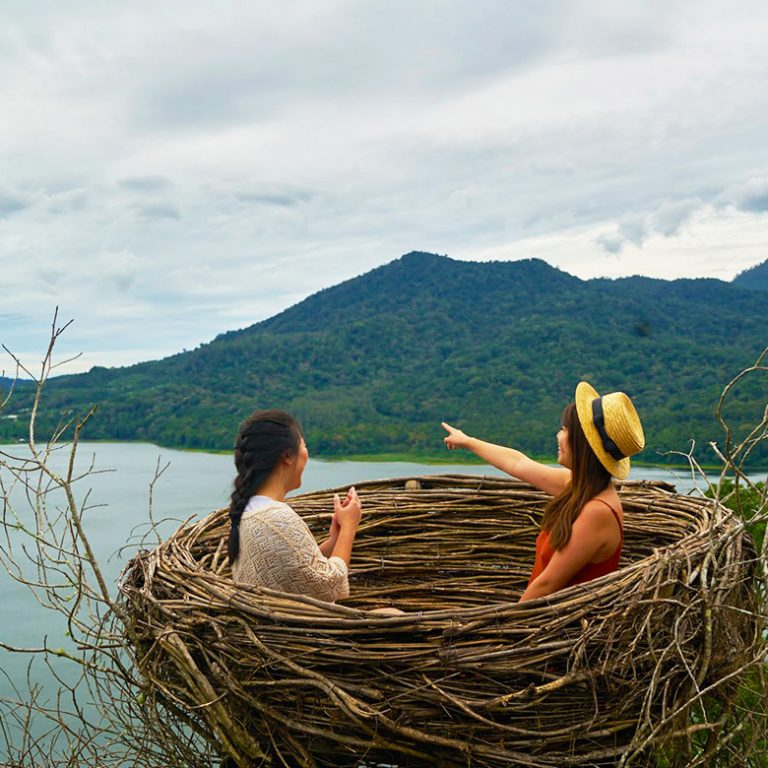 Remote workers sit in a life-sized nest in Bali, Indonesia