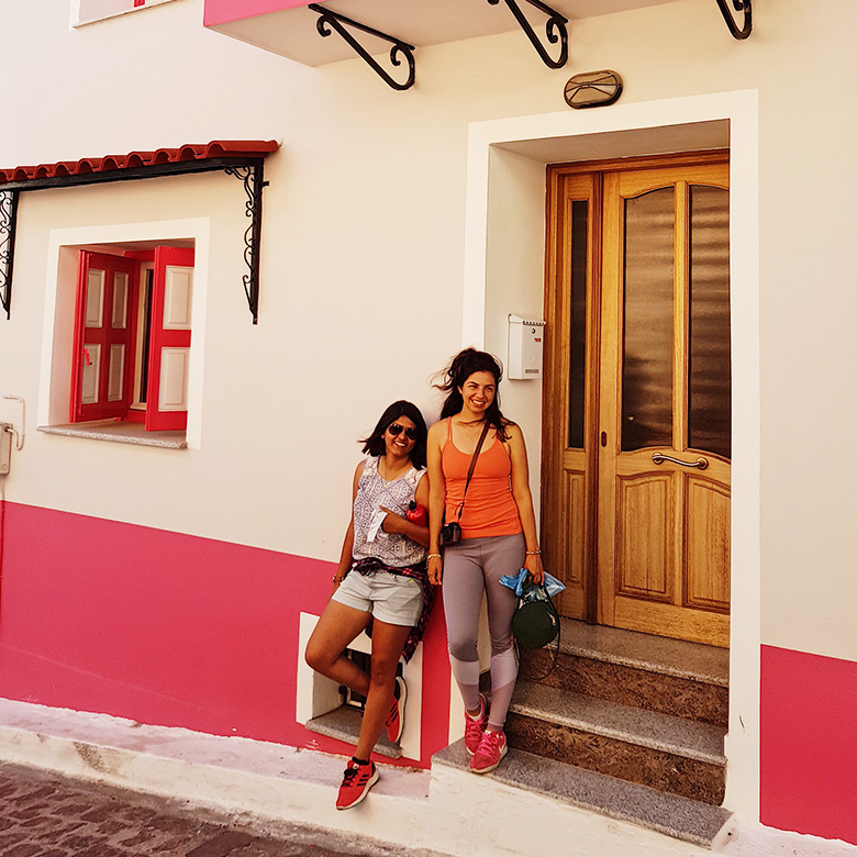Remote workers exploring the colorful buildings in Lesbos, Greece
