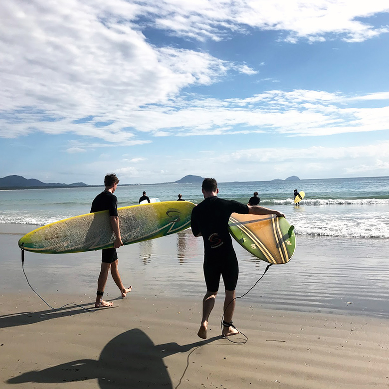 Remote workers take morning surfing lessons in Florianopolis, Brazil