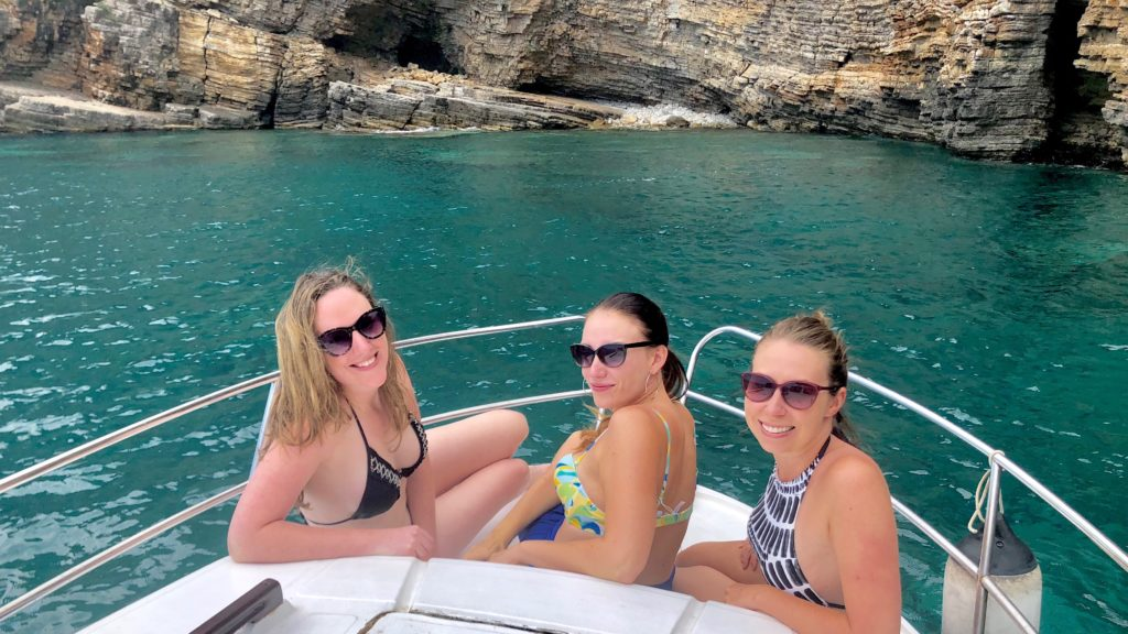 Remote workers on a boat in Italy as Hacker Paradise alumni