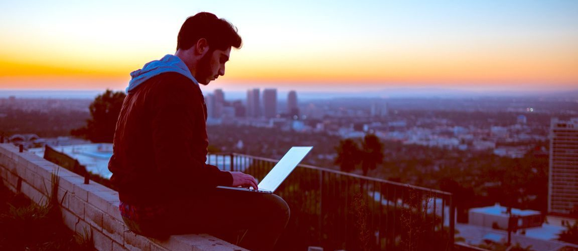 digital-nomad-working-at-sunset